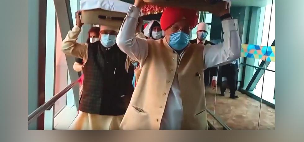 Indian Officials receive the three Swaroops of Shri Guru Granth Sahib from Kabul